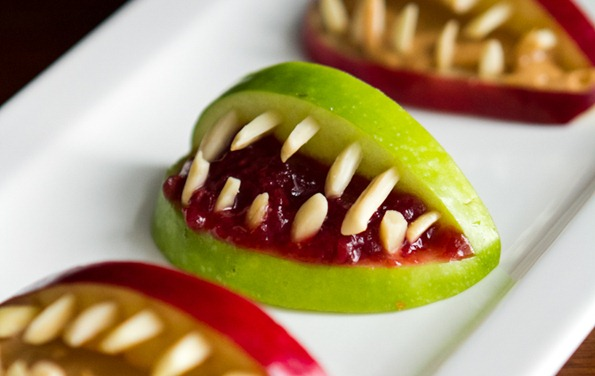http://ohsheglows.com/2012/10/15/3-ingredient-halloween-apple-bites/