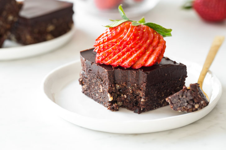 brownies with thinly sliced strawberry on top