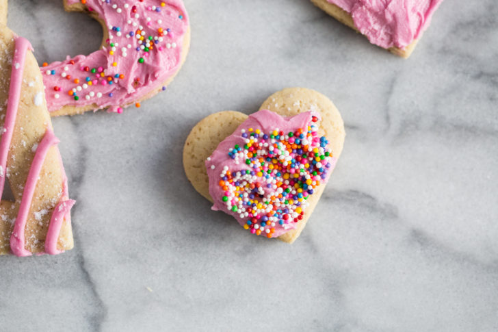 Heart shaped sugar cookie with coloured sprinkles
