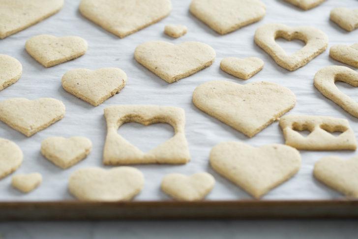 Heart shaped sugar cookies on baking sheet