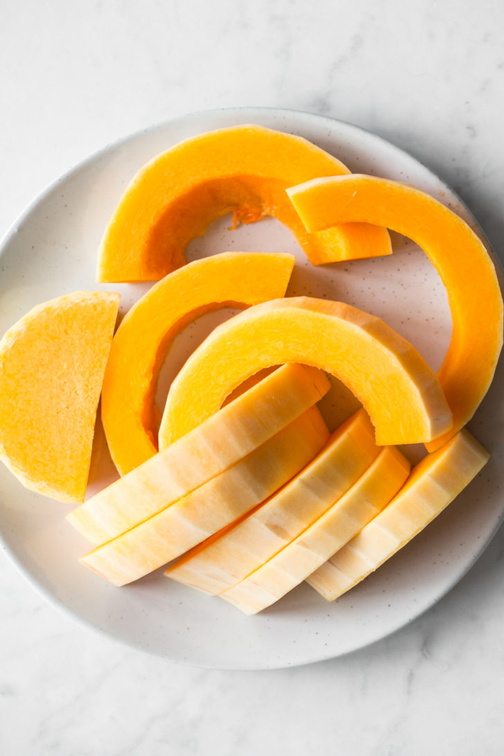 Butternut squash slices on white plate