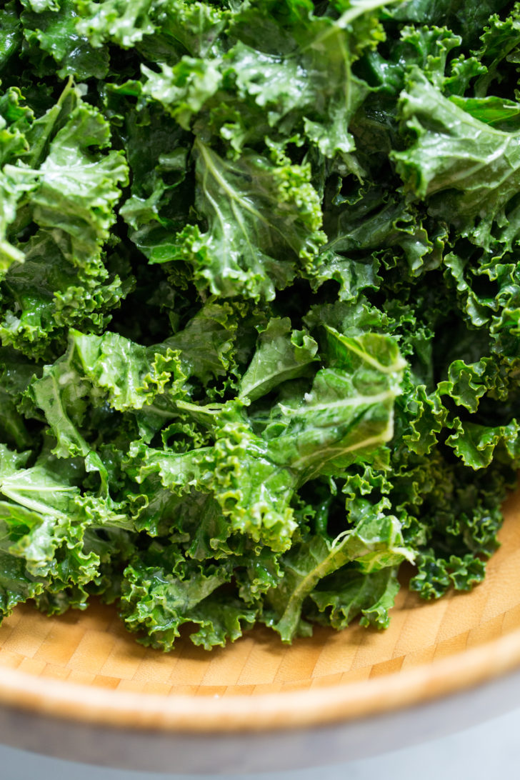 Closeup of kale salad in wood bowl